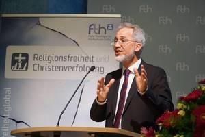 Photo: Christof Sauer bei seinem Vortrag © Martin Warnecke/IIRF