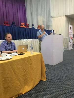 Photo: Dr. Fernando Da Silva during his speech, on the left Linus Pfister, Hilfsaktion Märtyrerkirche and RLP board member © Dr. Werner Nel
