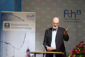 Photo: Thomas Schirrmacher bei seinem Vortrag © Martin Warnecke/IIRF